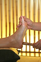 woman receiving foot massage, thaimassage