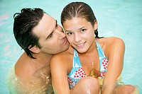couple in love relax in a swimming pool at a spa hotel