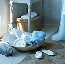 View of towels in basket with sandals
