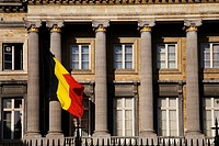 The Belgian National Flag flying at the Palais de la Nation in Brussels Belgium