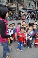 Hanoi (Vietnam): children by the Saint Joseph Cathedral at Christmas