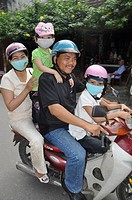 Hoi An (Vietnam): family on a motor-bike