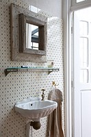 Wooden mirror in bathroom