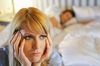 Couple in bed arguing