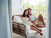 Couple sitting on patio daybed