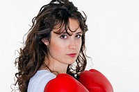 brunette young woman with red boxing gloves