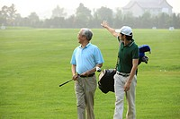 Two men walking on golf course