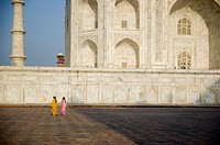 Two women walk around the Taj Majal, Agra, India
