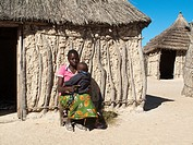Namibia - Kavango woman with child in her village near the town of Rundu  Kavango region, Namibia
