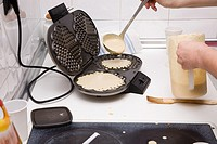 Making waffles in the kitchen