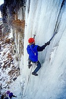 Man ice climbing a route called Chrome-Moly which is rated WI4 at the Mother Lode Area in the Snake River Canyon near the city of Twin Falls Idaho USA