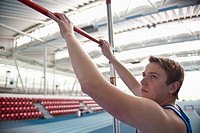 male athlete setting high jump bar
