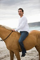 Brown horse, dark haired man, sea, beach,sand