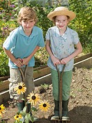 A boy and girl working in an allotment