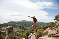Man on a cliff pointing