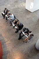 People sitting working with papers