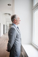 Businessman looking at window