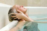 Woman receiving head massage in pool