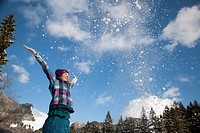 Girl throwing snow into the air