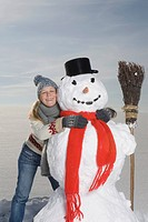 Germany, Bavaria, Munich, Woman hugging snowman