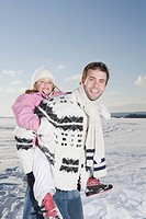 Germany, Bavaria, Munich, Father carrying daughter 6_7, smiling, portrait