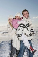 Germany, Bavaria, Munich, Family in snowy landscape, smiling, portrait