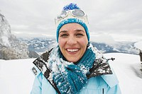 Italy, South Tyrol, Woman in winter clothes, smiling, portrait