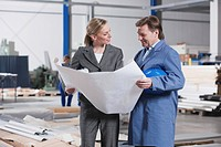 Germany, Neukirch, Female architect and foreman in industrial hall