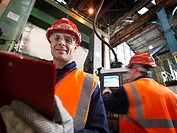 Steel Engineers In Plant With Clipboard