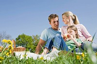 Germany, Bavaria, Munich, Family having picnic, girl 6_7 holding an apple, portrait