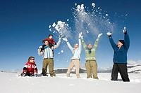 Italy, South Tyrol, Seiseralm, Family cheering in snow