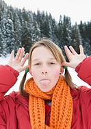 Italy, South Tyrol, Seiseralm, Girl 12_13 sticking out tongue, portrait, close_up