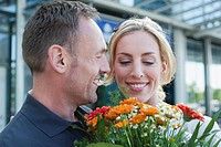 Germany, Leipzig_Halle, Airport, Couple with flowers, portrait