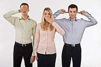 Business people gesturing see no evil, hear no evil, speak no evil