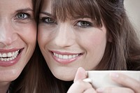 Germany, Cologne, Two women smiling, portrait, close_up