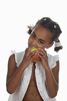 African girl 6_7 biting into apple, portrait