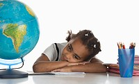 African girl 6-7 with globe, portrait (thumbnail)