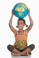 African girl 6_7 with globe on head, portrait