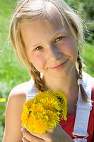 Austria, Salzkammergut, girl 10_11 holding flowers, portrait