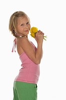 Girl 10_11 holding dandelion flowers, side view, portrait