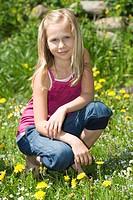 Austria, Salzkammergut, Girl 10_11 in garden