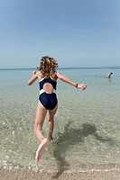 Spain, Mallorca, Girl 10_11 running into sea