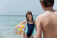 Spain, Mallorca, Children with beach ball on beach