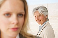 Spain, Mallorca, Two businesswomen, close_up
