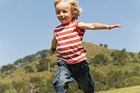 Spain, Mallorca, Boy 3_4 running in meadow