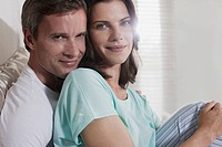 Germany, Hamburg, Couple sitting in bedroom, close_up