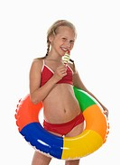 Girl 10_11 wearing bikini holding ice cream, smiling, portrait