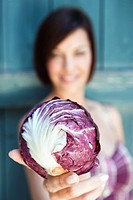 Germany, Bavaria, Woman holding radicchio