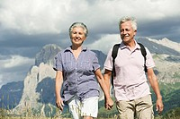 Italy, Seiseralm, Senior couple hiking hand in hand
