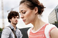 Germany, Berlin, Young couple, woman looking down, side view, portrait, close_up